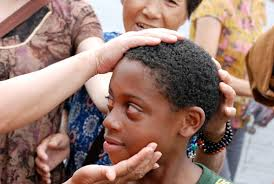 Chinese touch Black boy's hair