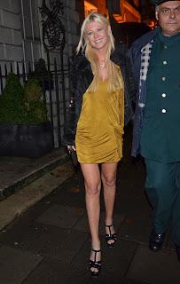 Tara Reid leggy in a goldish dress