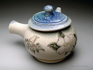 Teapot with mishima dogwood and bird by Lori Buff