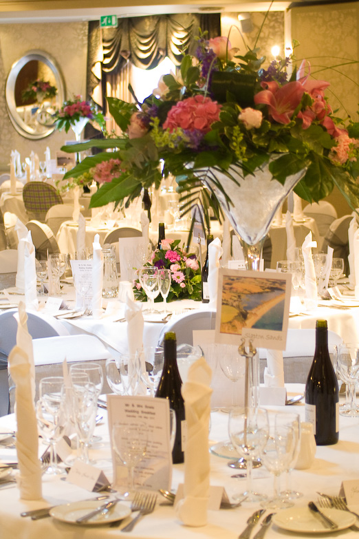Wedding guests enjoying the day Table layup including tributes to some