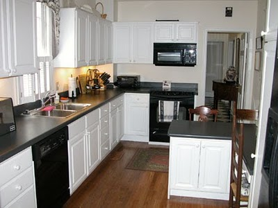 Hmh designs white kitchen cabinets timeless and transcendent - Kitchen designs with black appliances ...