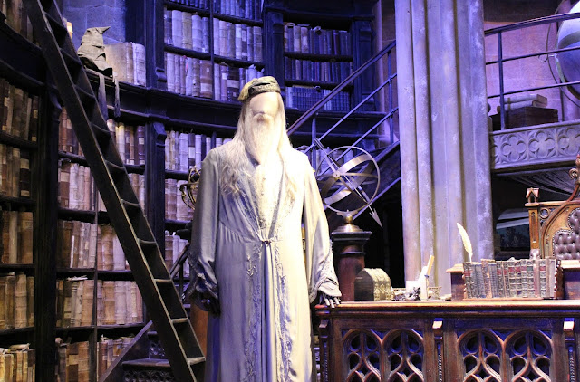 A picture of Albus Dumbledore's office and the sorting hat from Harry Potter