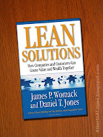 "Beauty shot picture of book by James Womack and Daniel Jones ""Lean Solutions"", ""How Companies and Customers Can Create Value and Wealth Together"""