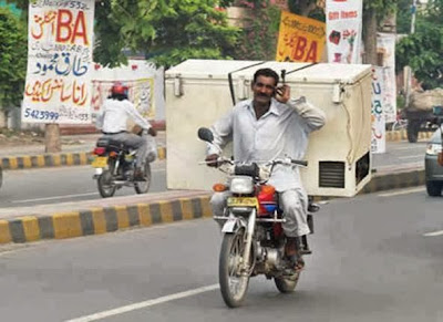carrying deep freezer on motorcycle amazing Pakistan