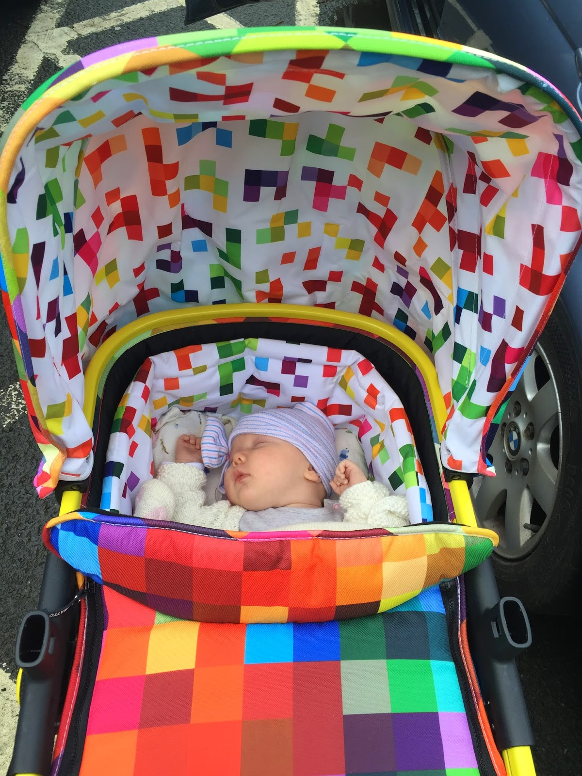 Bright coloured baby pram