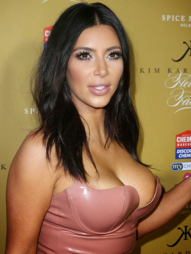 Kim Kardashian flaunts curvy body in a pink latex dress at perfume launch in Melbourne