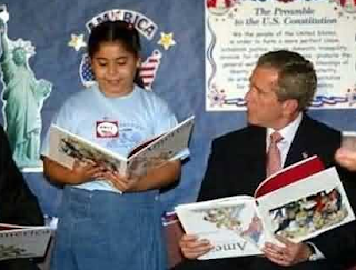 funny picture: george bush with the book upside down