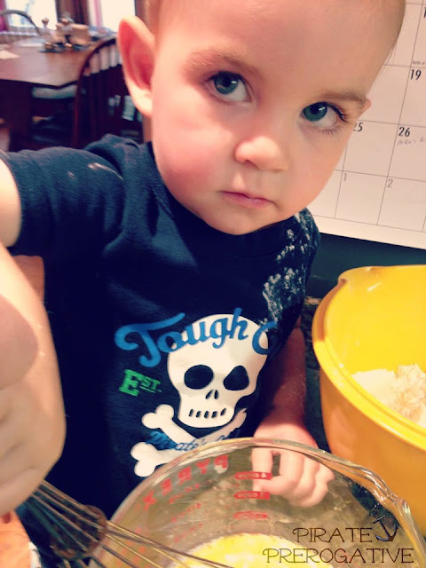 Helping whisk together the wet ingredients