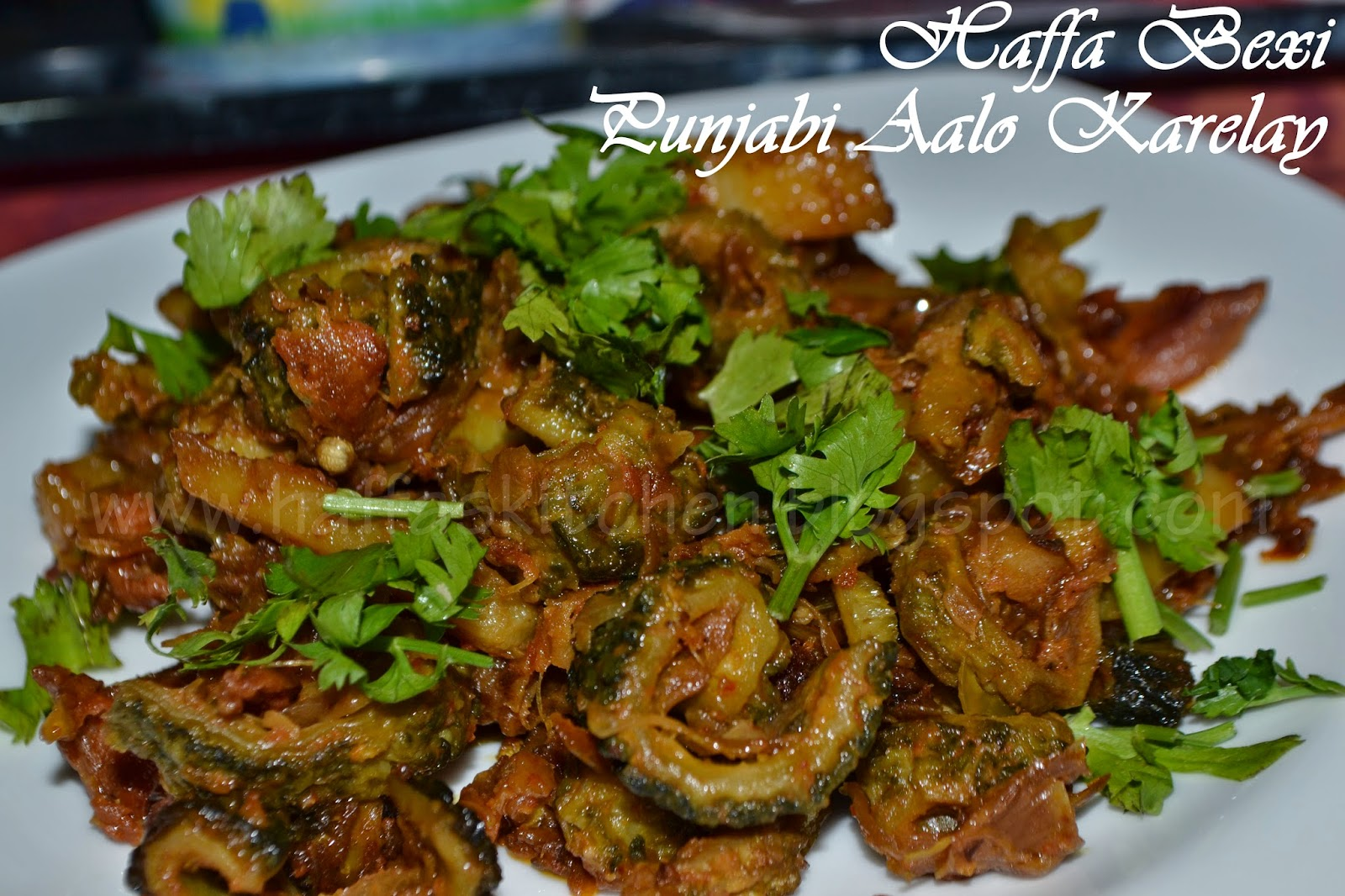 Fried bitter gourd with potatoes punjabi aaloo karelay haffas aalo karelay bitter gourd recipes indian vegetarian recipes punjabi aalo karelay vegetable forumfinder Image collections