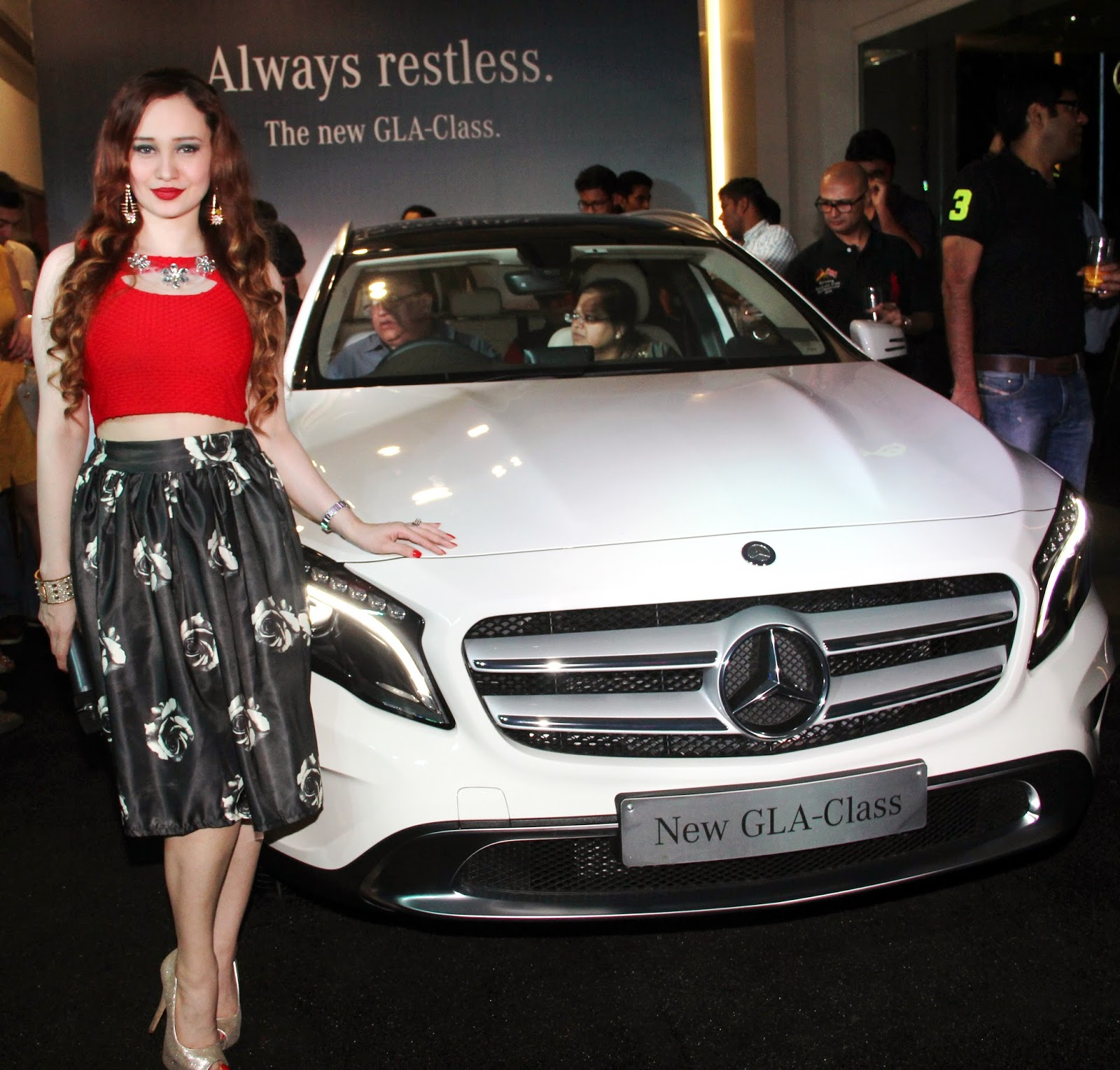 Stephanie Timmins posing with the Mercedes-Benz GLA-Class