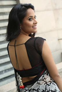 Anasuya looks sizzling spicy in Black White Floral Saree with Backless Transparent Choli Blouse