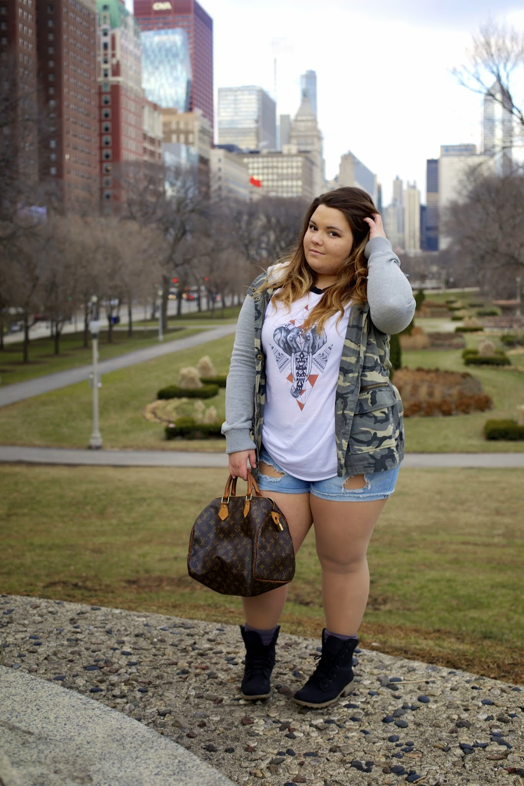 fatshion, fashion blogger, fat girl fashion, ankle boots with socks, chicago style, casual but stylish, How to rock a T-shirt, ripped shorts, destroyed denim, curvy girls, plus size fashion blogger, thick girls, camouflage jacket, forever 21, black matte timberlands, natalie craig, natalie in the city, Kadi klothing