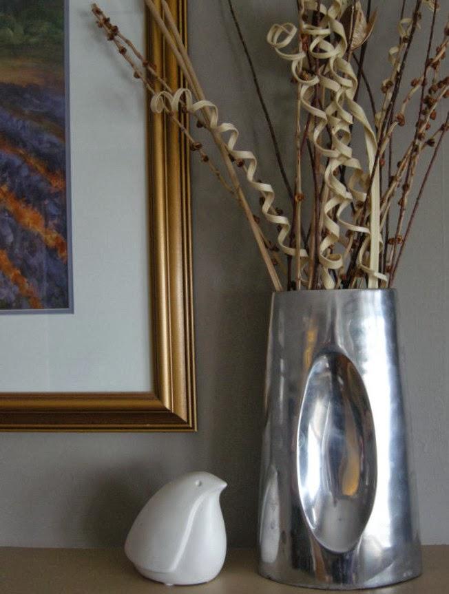 white stylized bird on shelf