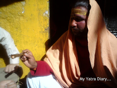 Priest chants holy mantras for the devotees