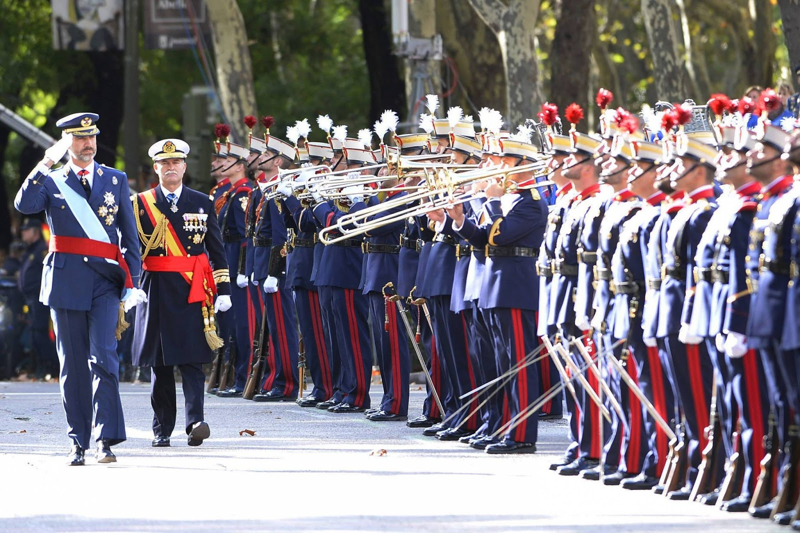 King Felipe, Queen Letizia, Princess Leonor and Princess Sofia of Spain attend the military parade at the National Day in Madrid