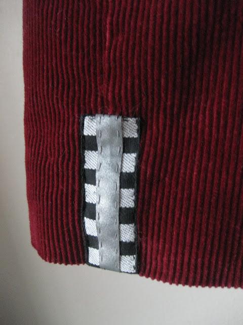 heijastimen ompelu vaatteeseen
