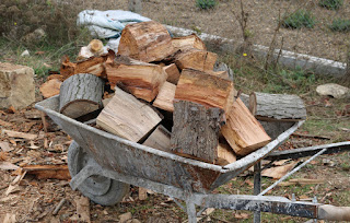 Full wheelbarrow of split wood