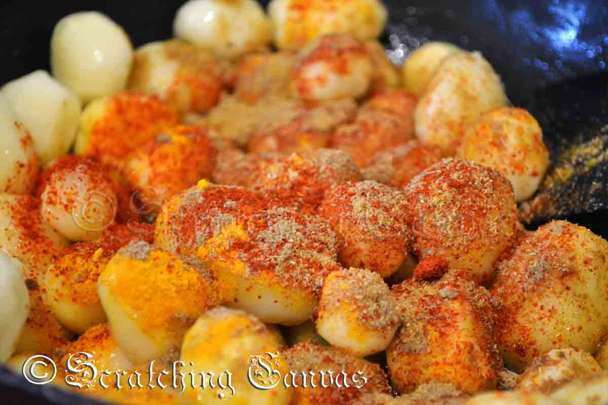 Mix all thespices well so that each potato gets coated with the spices ...