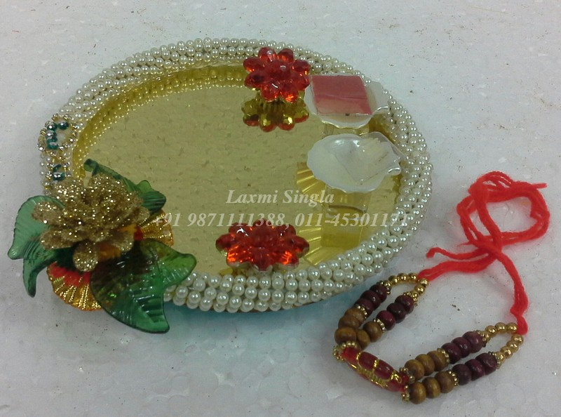 Pooja thali for rakhi pooja aarti thali decoration for Aarti decoration pictures