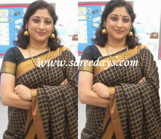 Latest saree designs lakshmi gopalaswamy in black kanchipuram silk checkout lakshmi gopalaswamy in black kanchipuram silk saree with zari border and paired with matching short sleeves blouse altavistaventures Images