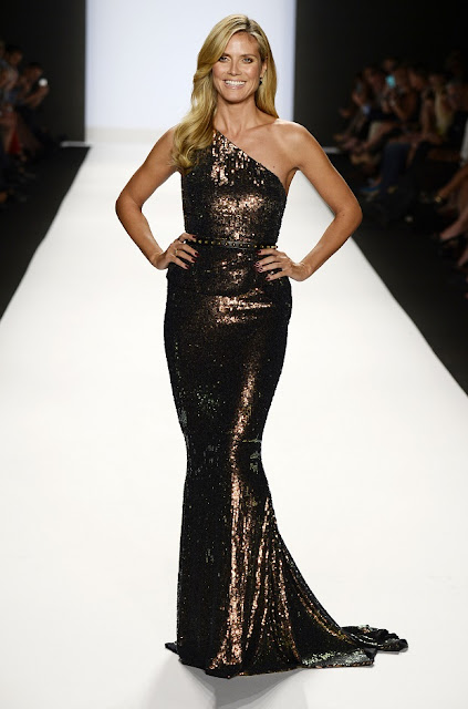Heidi Klum in a one-shoulder gown at the Project Runway Spring 2014 Fashion Show