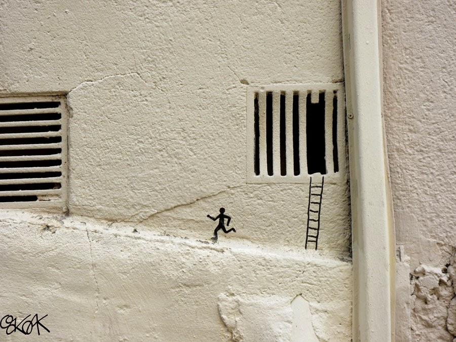 08-The-Escape-2-OakOak-Street-Art-Drawing-in-the-City-www-designstack-co