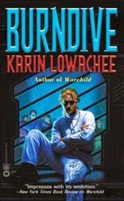Cover art for Burndive, featuring a blonde boy of Asian descent. He wears a white silk suit and occupies a prison cell, arms crossed and one foot raised onto the seat beside him.