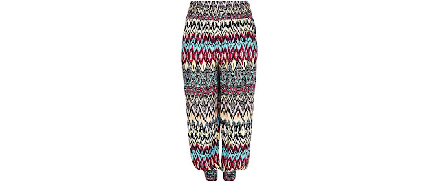 http://www.newlook.com/shop/inspire-plus-sizes/trousers-and-shorts/samya-orange-tribal-print-harem-trousers-_356339489
