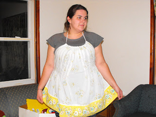 white and yellow apron made from pillowcase