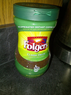 Container of instant coffee powder