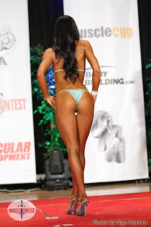 Kayla Rose posing during bikini competition