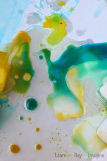 Combining ice chalk and oil - a simple and gorgeous art activity for kids