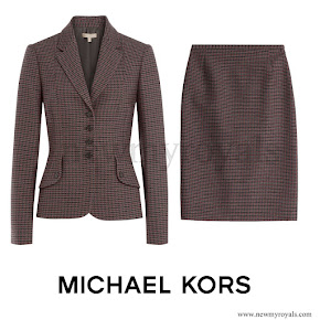 "The Duchess wore Michael Kors Skirt Suit. The Virgin Wool Plaid Blazer is described as a ""vintage-inspired equestrian silhouette"" with notched lapels, long sleeves, four-button closure and plaid knit print."