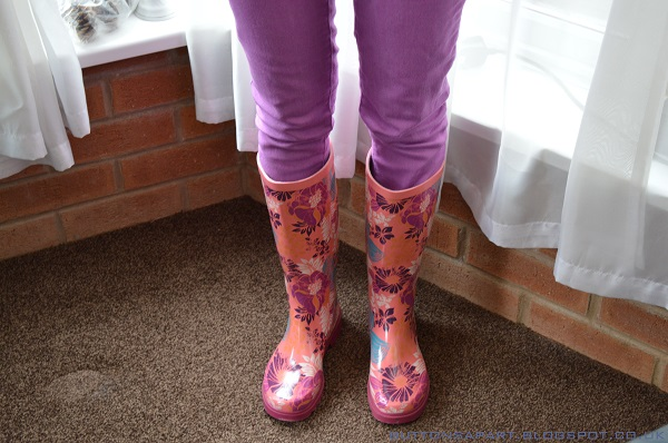 a picture of an outfit featuring floral print wellie's