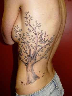 tattoo on rib cage for girls. Rib Cage Tattoo Hurts Girl