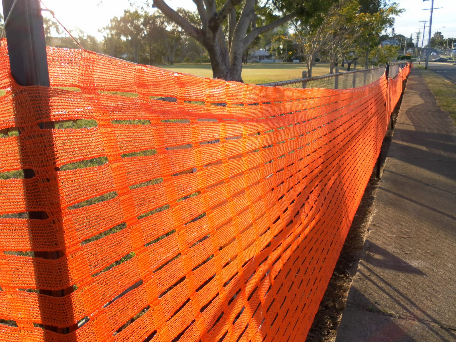 journey walking and orange plastic fence This tenax orange guardian safety barrier fence is perfect for sporting events,  concerts, fair and carnivals  material, composite, composite, composite, vinyl.