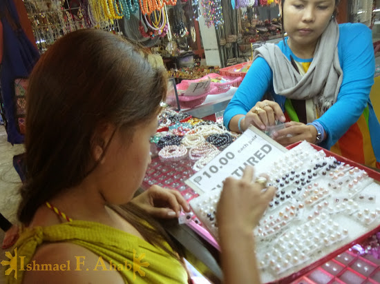 My Beloved Wife Lei buying pearl earrings in LRC Market Mall, Puerto Princesa