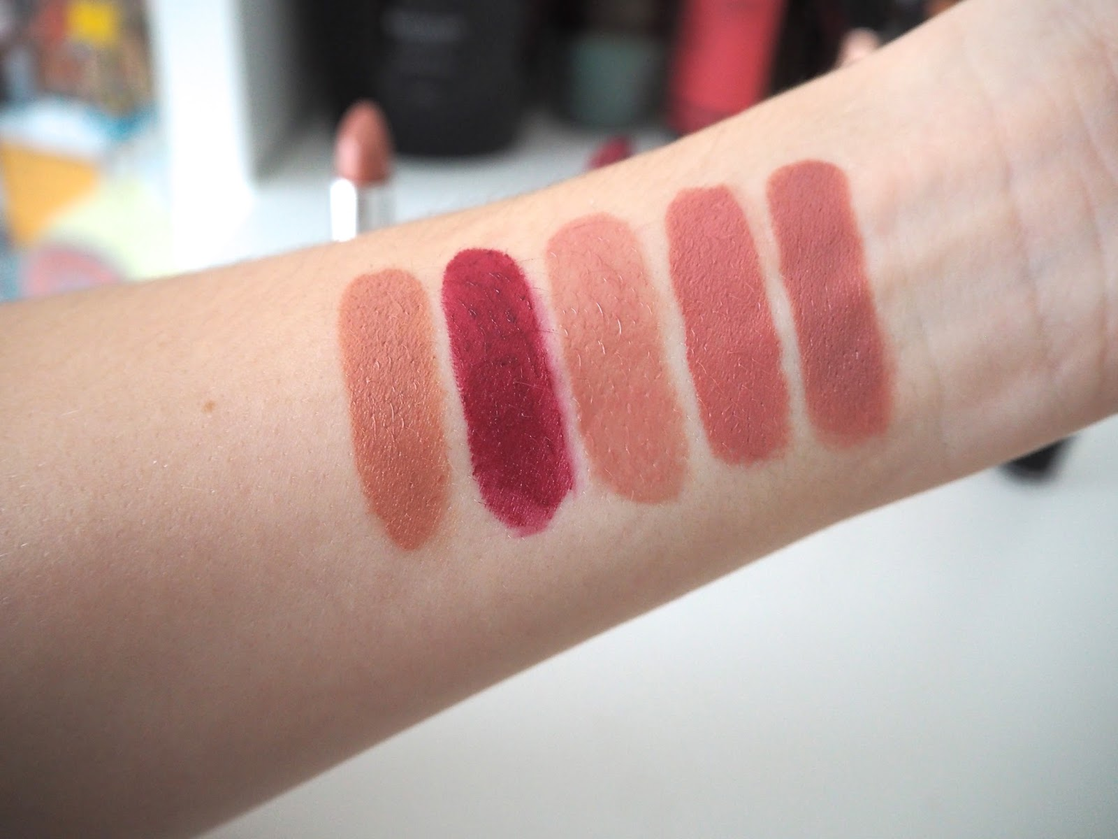 My Favourite Drugstore Lipsticks, best drugstore lipsticks, nude, bold, pink, red, rimmel kate moss, 43, 107, catrice luminous lips lipstick, h&m beauty, hm, seashell, wet 'n wild bare it all, megalast lipstick, swatches