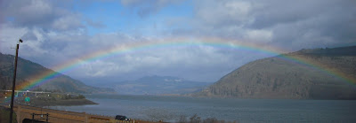 a rainbow arches across the Columbia River at Mosier, Oregon