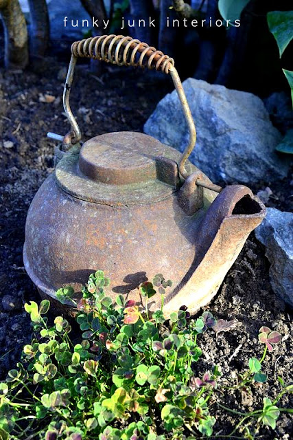 Old rusty kettle in the garden / part of summer garden reveal on FunkyJunkInteriors.net