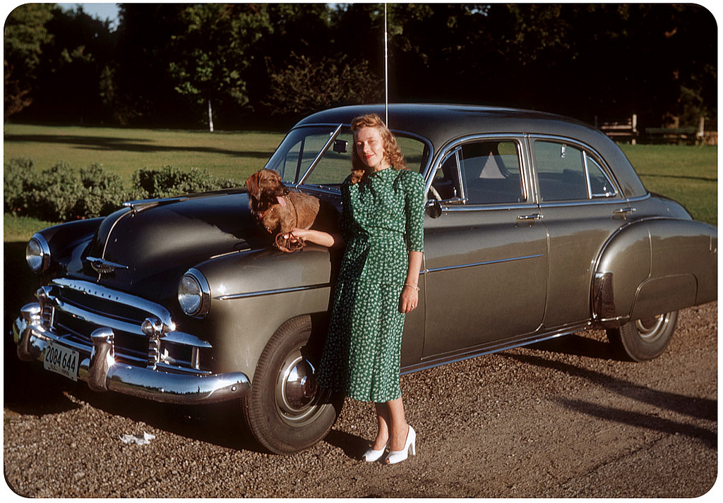 A girl with her dog on the chevrolet styleline deluxe 4 for 1950 chevy styleline deluxe 4 door sedan