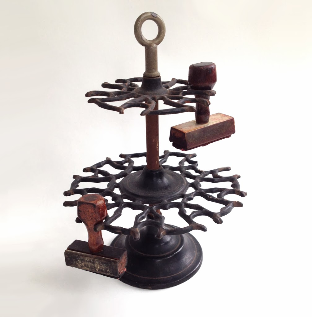 https://www.etsy.com/listing/178018816/antique-2-tier-cast-iron-rubber-stamp?ref=shop_home_active_6