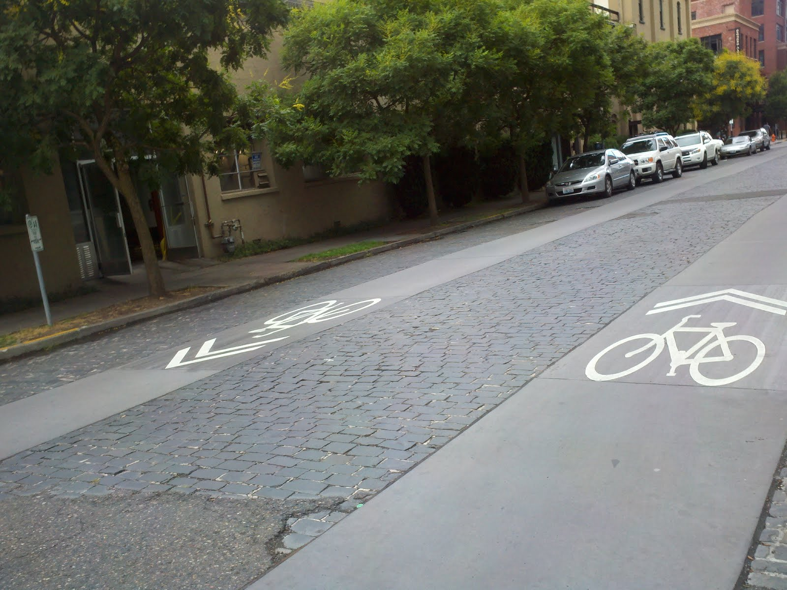Concrete Cobble Street : Quaint cobblestone street ripped up for bike paths in nw