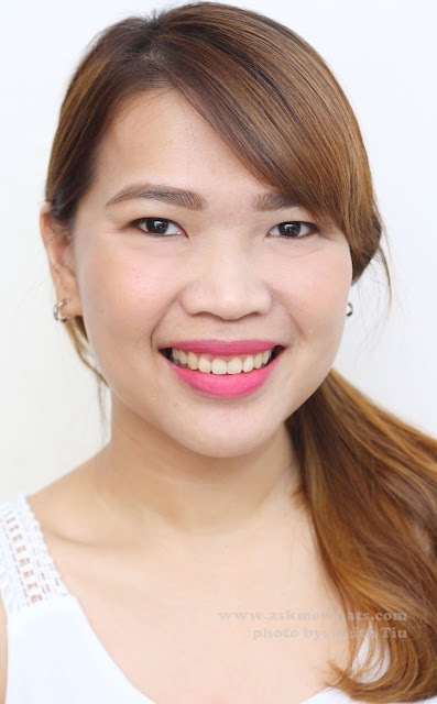 A photo of a girl wearing  Sleek True Colour Lipsticks in Pink Freeze