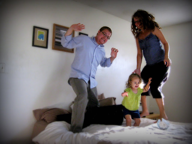 jumping on the bed for family photo