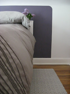 close up detailed picture of rounded corner on painted headboard