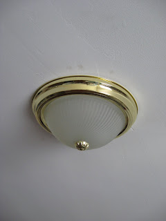 image of standard brass ceiling fixture that looks like a woman's breast