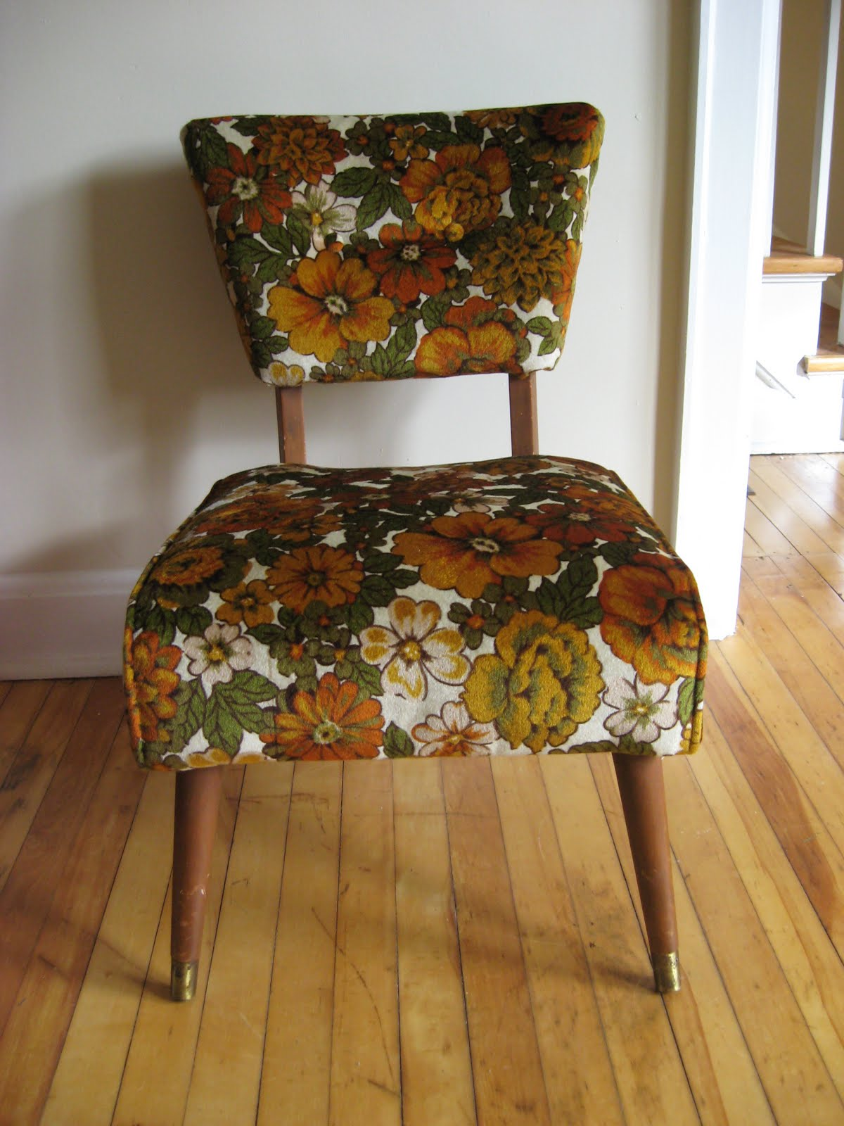 ugly thrift store chair covered in nineteen seventies floral fabric