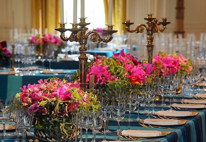 Spotlight the first florist craft and couture lauras arrangements for the mexican state dinner featured prickly pear cactus in a bed of hot pink flowers contrasted with blue silk table cloths mightylinksfo