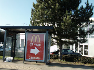Sign Pointing To Our Local McDonalds